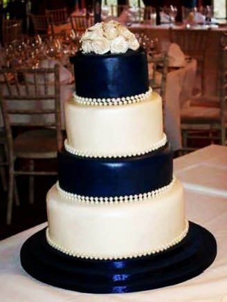 4 tiered navy & ivory wedding cake